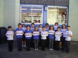 Some members of P3 receiving their two times table certificate.